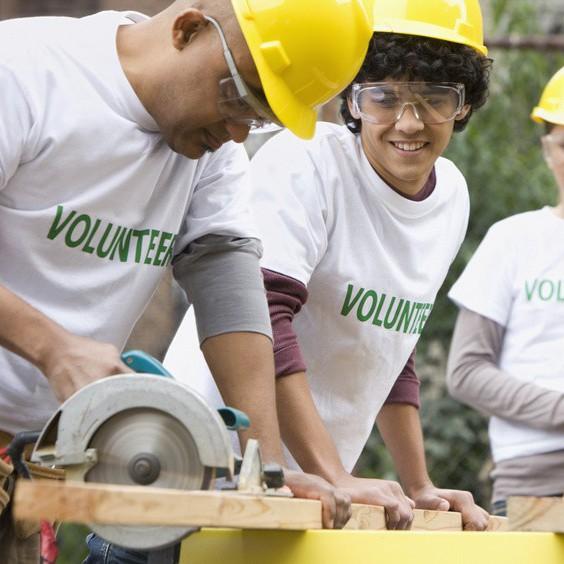 Volunteers working on construction site