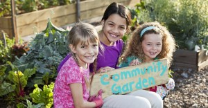 Girls holding community garden sign