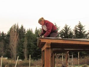 Jen McAllister working on the roof of the learning garden