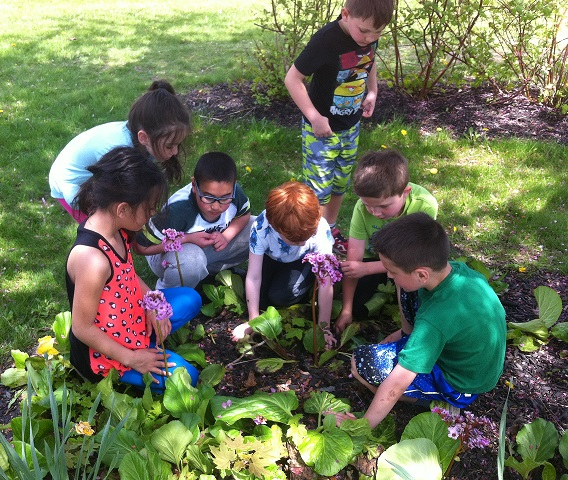 In the garden, children engage with all their senses, making learning concrete and memorable