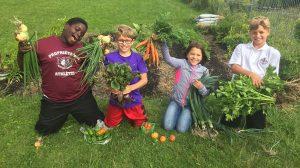 4 Kids with vegetable harvest